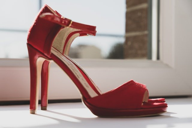 Red ladies shoes with strap and 6 inch heels